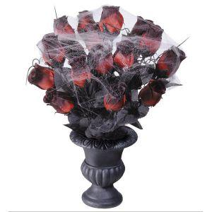 Florero rosas con telaraña
