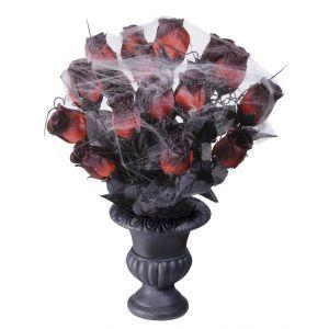 Florero rosas con tela ara?a