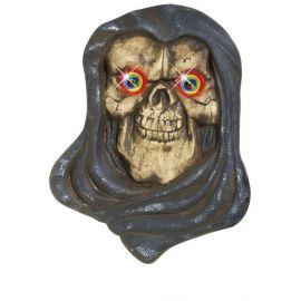 Figura muerte ojos piedra